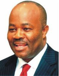Governor Akpabio smiles at the plot.jpg