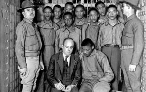 Attorney Sam Leibowitz confers with Haywood Patterson in a jail cell as other Scottsboro Boys stand by. Photograph: New York Daily News Archive/Getty Images