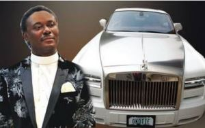 Rev. Okotie and his N120m Rolls Royce Car