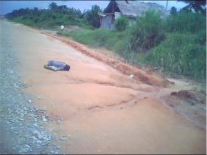 Little Nkoyo sleeping by the side of the Oron East West Road