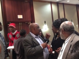 Ambassador Assam Assam chatting with top academic during Town Hall Meeting in Houston Texas
